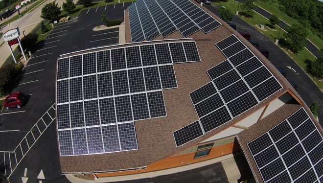 Solar panels atop the Evergreen Credit Union in Neenah help illustrate how customer-sited renewable energy systems have expanded sixfold in seven years.