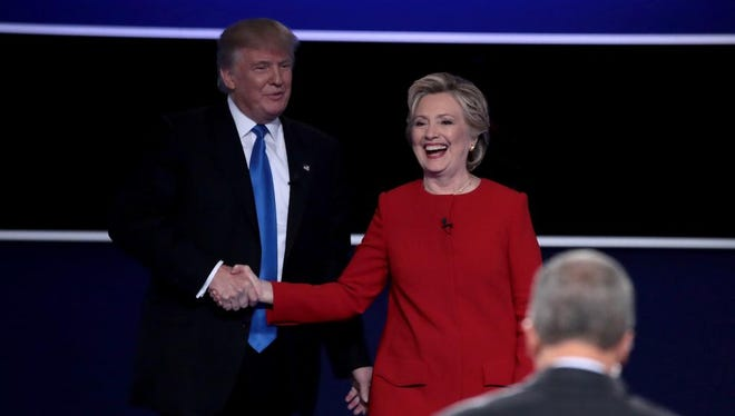 Republican presidential nominee Donald Trump and Democratic presidential nominee Hillary Clinton shake hands after the Presidential Debate at Hofstra University on Monday.