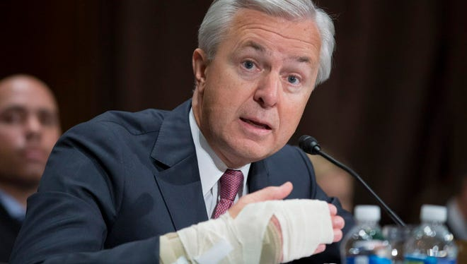 Chairman and CEO of the Wells Fargo and Company John Stumpf responds to a question from Democratic Senator from Massachusetts Elizabeth Warren (not pictured) during the Senate Banking, Housing and Urban Affairs Committee hearing on 'An Examination of Wells Fargo's Unauthorized Accounts and the Regulatory Response', on Capitol Hill in Washington, DC, USA, 20 September 2016.