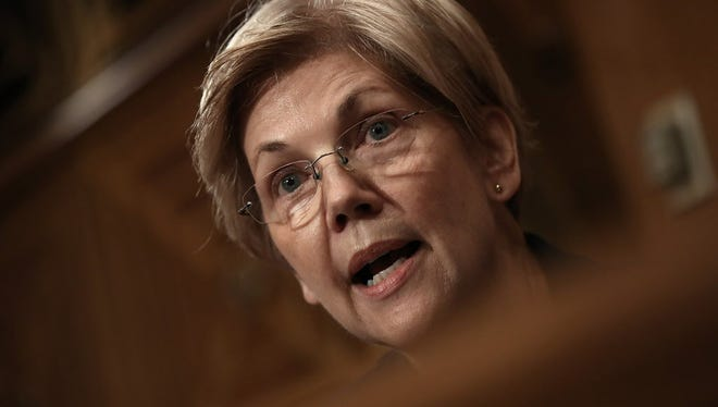 Sen. Elizabeth Warren (D-MA) questions John Stumpf, chairman and CEO of the Wells Fargo & Company, during a hearing of the Senate Banking, Housing and Urban Affairs Committee September 20, 2016 in Washington, DC.