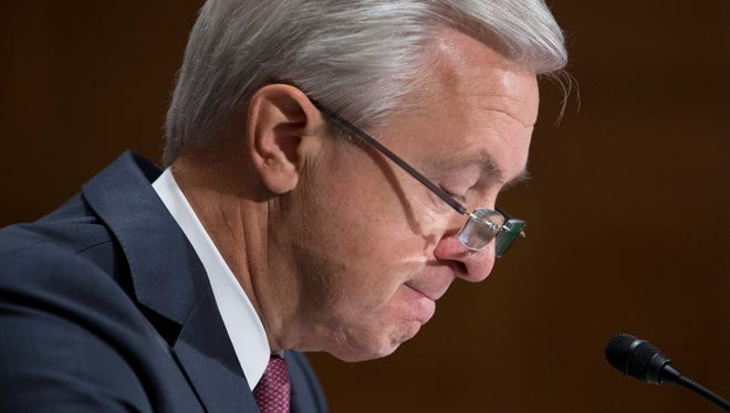 Former Wells Fargo CEO John Stumpf appearing before a Congressional panel.