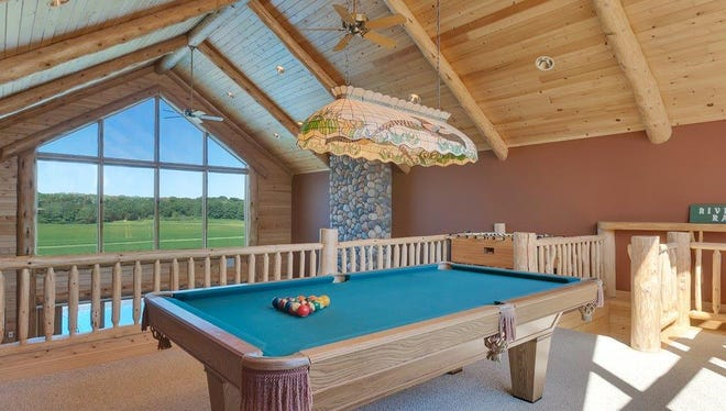 Situated right above the garage, the bonus room has a balcony-style view of the great room.