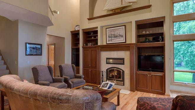 The main floor family room has an alcove above the fireplace to display some of your most prized possessions.