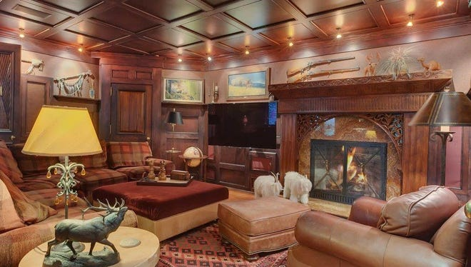 Cherry wood walls and ceiling add a classic touch to the media room.
