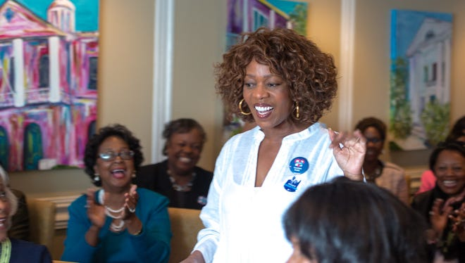 Actor Alfre Woodard addresses  30 of Tallahassee's prominent African American women as she stomps for Hillary Clinton at the Governors Club Monday afternoon.