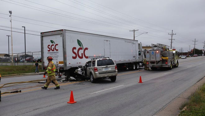 Firefighters respond to a crash on Battlefield Road near Scenic Avenue.