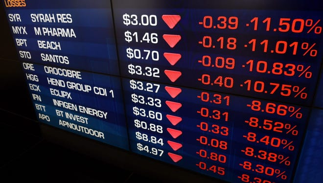 Stock prices are displayed on an information screen at the Australian Stock Exchange in Sydney, Australia, 09 November 2016.