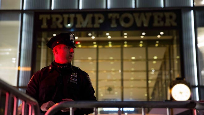 A police officer stands outside Trump Tower in New York City on Election Day Nov. 8, 2016.