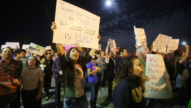 Hundreds of protesters against Donald Trump gathered at Frances Stevens Park in Palm Springs on November 12, 2016.