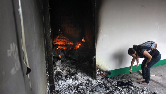"""Fire burns in the Municipal Palace in Catemaco, Veracruz, after it was set on fire, Sunday, Nov. 13, 2016. Two days of unrest were caused by the abduction three days ago of Rev. Jose Luis Sanchez Ruiz. Sanchez Ruiz has been found alive, but """"with notable signs of torture,"""" the Roman Catholic Church said Sunday."""