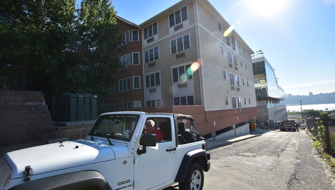 Fred Daibes, a developer in Edgewater, driving past one of his affordable housing complexes at 1 Vreeland Place.