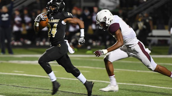 Paramus Catholic running back Alijah Jackson breaks off a big run in the first half.
