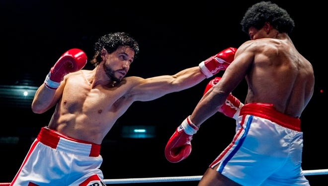 "This image released by The Weinstein Company shows Edgar Ramirez, left, and Usher Raymond in a scene from, ""Hands of Stone."" (Rico Torres/The Weinstein Company via AP)"