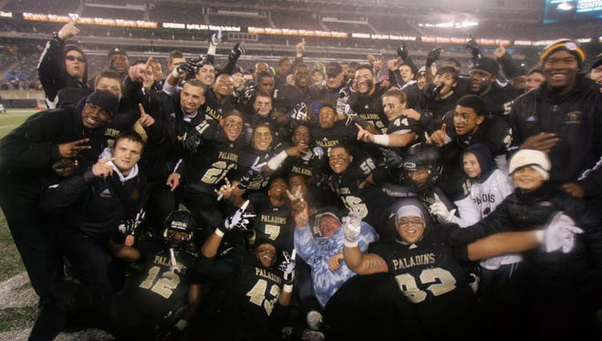 Paramus Catholic, shown here after winning the 2013 state title, will look to capture its fourth championship in program history when it takes on St. Peter's Prep on Friday night.