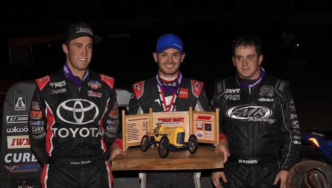 NASCAR star Kyle Larson (center) won the 76th running of the Turkey Night Grand Prix last Thursday on the final night of the 2016 Ventura Raceway season.