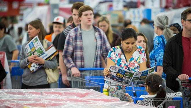 Shoppers line up at Walmart's Black Friday event on Thursday, Nov. 24, 2016 in Bentonville, AR.