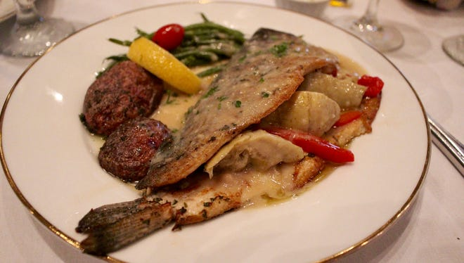 The Idaho Blue Trout is stuffed with artichokes, red bell peppers and capers.