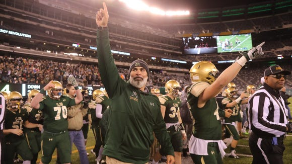 Don't Hassle the Hoff....St. Joseph head football coach Augie Hoffmann celebrates first state title with Green Knights.