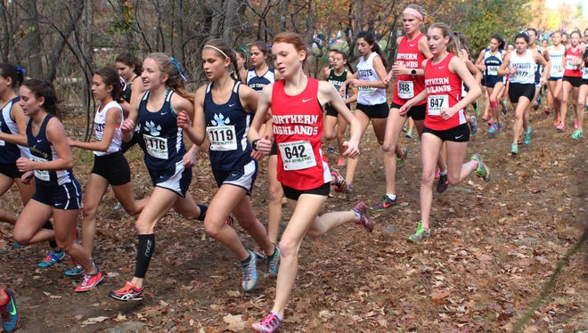 Northern Highlands' Isabel Hebner, center, and a legion of other North 1, Group 3 runners enter the wooded area at the start of the state sectional race at at Garret Mountain.