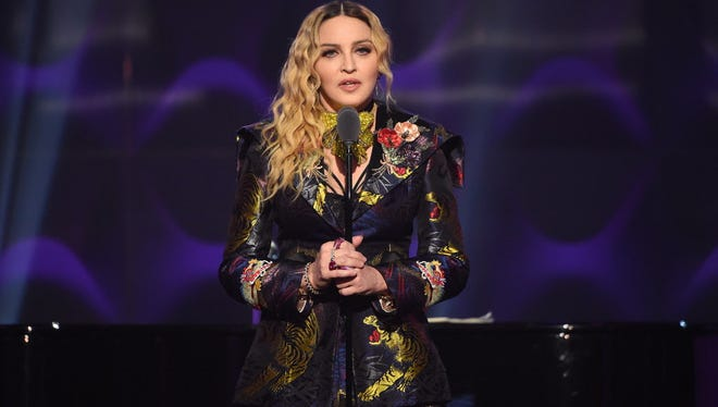 Madonna speaks on stage at the Billboard Women in Music 2016 event on December 9, 2016 in New York City.