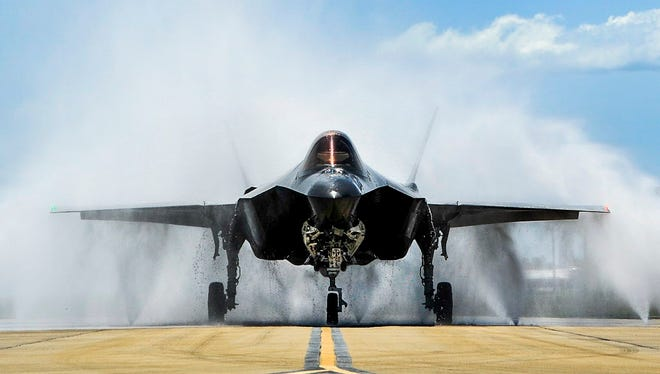 "Lt. Col. Christine Mau, 33rd Operations Group deputy commander, navigates her F-35A through the ""bird bath"" after returning from her first flight on Eglin Air Force Base, Fla., May 5, 2015."