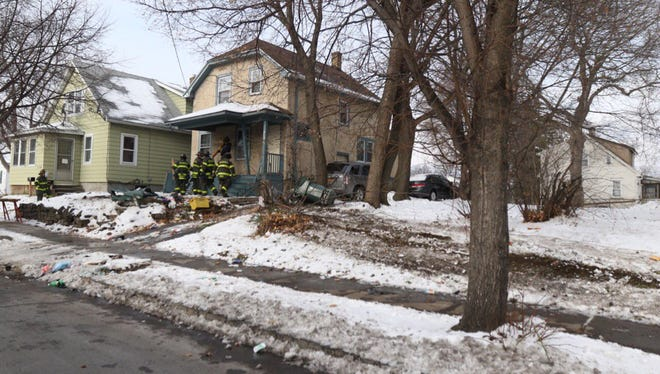 Rochester firefighters on scene on an accident on Northland Avenue on Tuesday where a teen driver flipped her car and hit a house.