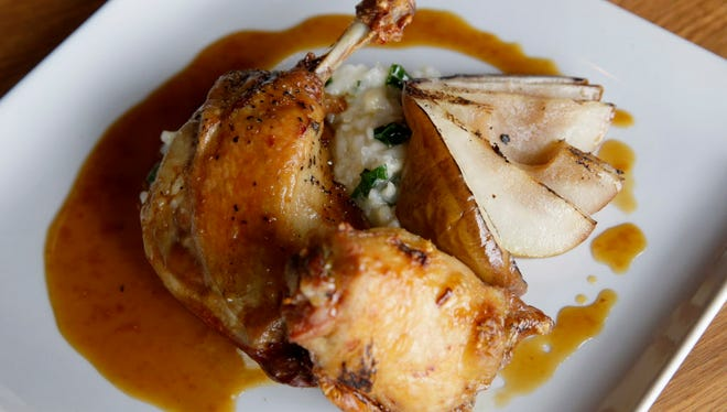 The chicken and duck thighs on the menu at Tofte's Table, 331 Riverfront Plaza in Waukesha, are served with grilled pear, kale risotto and pear reduction.