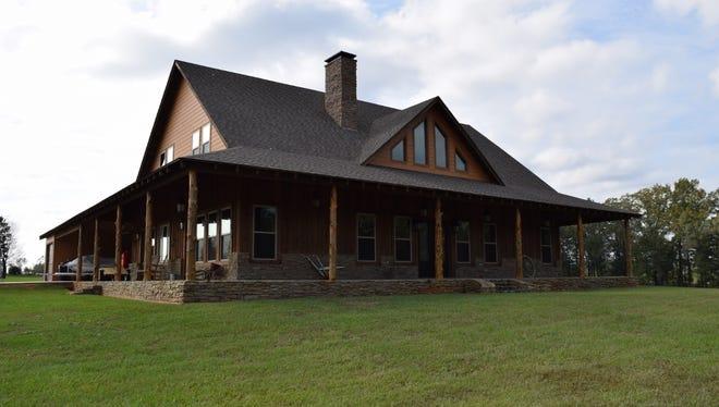 Custom-built energy efficient $600K home showcases Cedar and Arkansas stone.