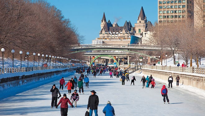 People skating on the Rideau Canal Skateway in  Ottawa, Canada, during the Winterlude Festival.