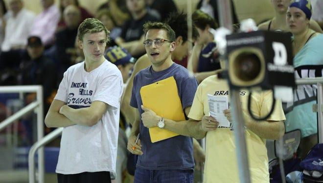 Indian Hills senior swimmer Matt Smits, left, watching a meet with coach Bryan McDonnell.
