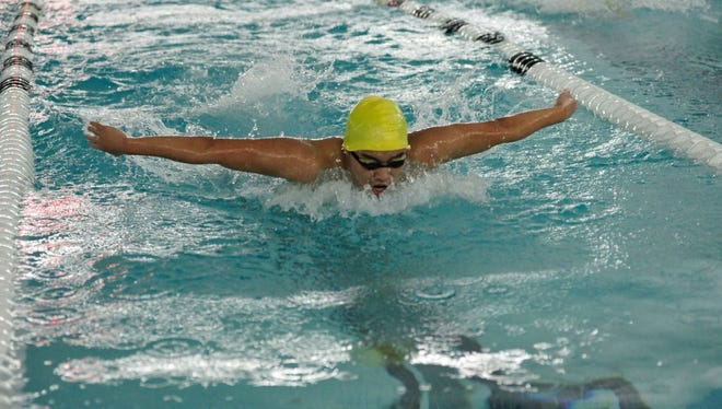 Josh Oh swimming the butterfly for NV/Demarest against Indian Hills on Tuesday.