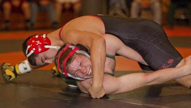 Joey Schiele, top, has a chance to reach 100 career victories for Morris Hills.