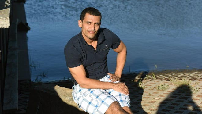 Jay Moss of Secaucus jumped from a bridge and rescued a woman from the Passaic River.