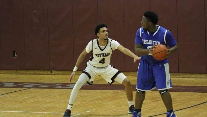 Danny Santana, left, had 23 points and eight rebounds as Clifton beat Passaic on Dec. 16.