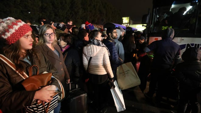 More than 1,000 people were estimated to be on line for NJ Transit buses after the Jersey Gardens Mall was evacuated on one of the busiest days of the year after a fight broke out.