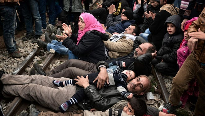 Syrian and Iraqi refugees trapped at the Greek-Macedonian border on Fe. 28.