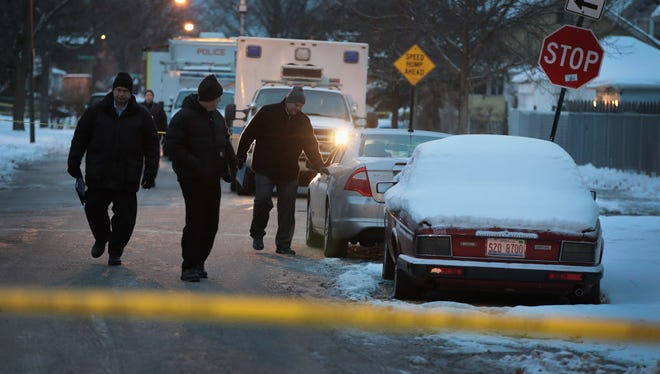 Police investigate the scene of a quadruple homicide on the city's South Side on December 17, 2016 in Chicago, Illinois. Three people were found shot to death inside a home in the Fernwood neighborhood, another 2 were found shot outside the home, one of those deceased. Chicago has had more than 750 murders in 2016.