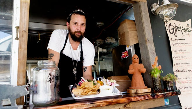 Gypsy Taco chef-owner Mitch Ciohon at his truck in summer 2016, which is parked permanently behind the Boone & Crockett patio, 2151 S. Kinnickinnic Ave. The truck was damaged in a minor fire on New Year's Day.