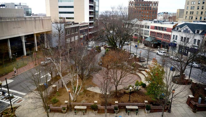 Downtown's Prichard Park is seen from above on Wednesda. It has been proposed that the city build fences in the park to protect the trees and future landscaping.