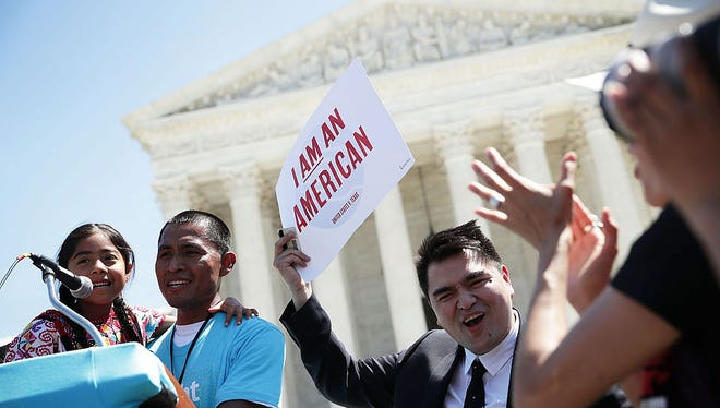 Six-year-old Sophie Cruz (left) speaks during a rally in front of the U.S. Supreme Court next to her father Raul Cruz  and supporter Jose Antonio Vargas (far right) on April 18, 2016 in Washington, DC. The Supreme Court heard oral arguments in the case of United States v. Texas, which is challenging President Obama's 2014 executive actions on immigration - the Deferred Action for Children Arrivals (DACA) and Deferred Action for Parents of American and Lawful Permanent Residents (DAPA) programs.