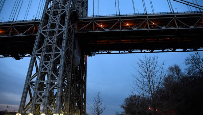 A security booth (right, light on top) sits at the base of the George Washington Bridge on the New York side.