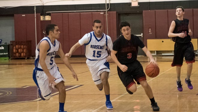 Ethan Reisbaum (right) scored 11 points for Northern Highlands against NV/Old Tappan.