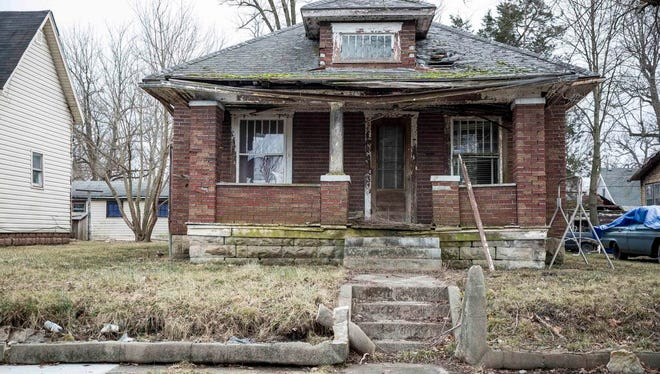 The home at 715 E. Eighth St., which stands vacant, could be demolished in the next round of blight elimination by the city. The city has from 2,000 to 4,000 blighted properties, according to various estimates.