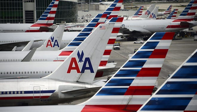 American Airlines passenger planes are seen at Miami International Airport on June 8, 2015.