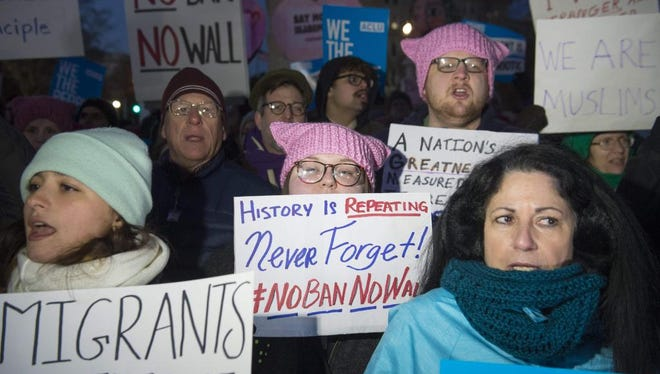 Demonstrators protest against US President Donald Trump and his administration's ban of travelers from 7 countries by Executive Order, during a rally outside the US Supreme Court in Washington, DC, on January 30, 2017. Trump's executive order suspended the arrival of all refugees for at least 120 days, Syrian refugees indefinitely -- and bars citizens from Iran, Iraq, Libya, Somalia, Sudan, Syria and Yemen for 90 days.  Protests are taking place at airports across the country in opposition to the ban. / AFP PHOTO / SAUL LOEBSAUL LOEB/AFP/Getty Images