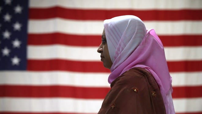 Immigrant at a naturalization ceremony in New York on Aug. 16, 2013.