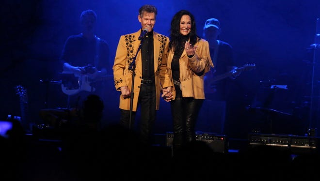 "Randy Travis and Mary Travis sing ""Amazing Grace"" at ""1 Night. 1 Place. 1 Time.: A Heroes and Friends Tribute to Randy Travis"" at Bridgestone Arena on Feb. 8, 2017, in Nashville."