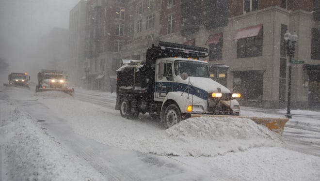 Snowplows clear Berkeley Street in whiteout conditions Feb. 9, 2017, as a winter storm bears down in Boston. Another snowstorm has been forecast with up to a foot of snow in a large swath of the Northeast.