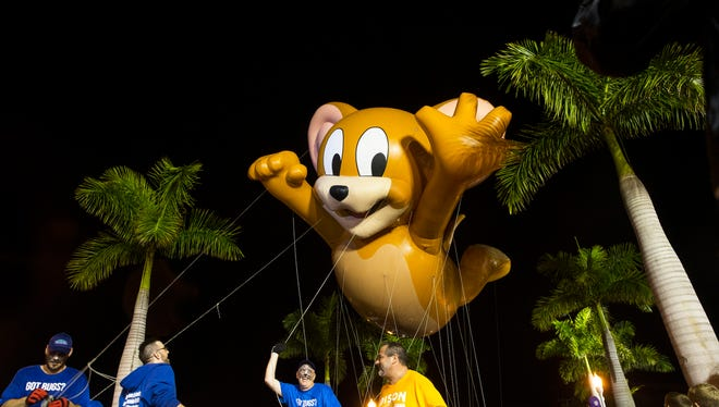 Jerry the Mouse glides down the street with Fort Myers Pest Control during The Edison Festival of Light Grand Parade in downtown Fort Myers, Florida on Saturday, Feb. 18, 2017. Named as the largest night parade in the Southeast year after year, the parade brings the entire Southwest Florida community out in celebration of the life and achievements of our local winter resident, Thomas Edison.