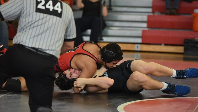 Kenny Pena (top) finished in second place for Cliffside Park, advancing to Region 3.